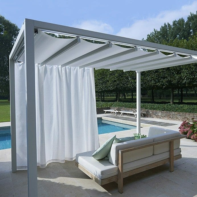a poolside cabana with the roof closed and curtain partially drawn