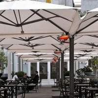 P6 Square Quattro Umbrellas at an outdoor dining area