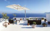 Veneto Cantilever Umbrella on a deck by the Mediterranean sea