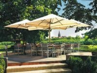 P6 Square Quattro Umbrella at an outdoor dining area