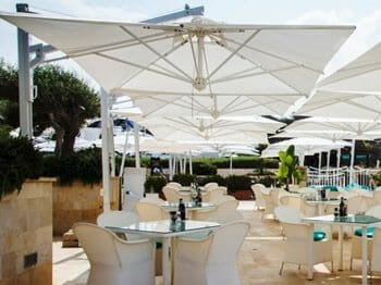 veneto maxi umbrellas over an outdoor dining area