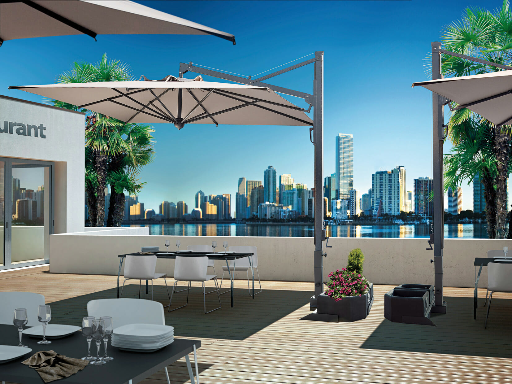 veneto umbrellas over outdoor dining area with a cityscape over the water in the background