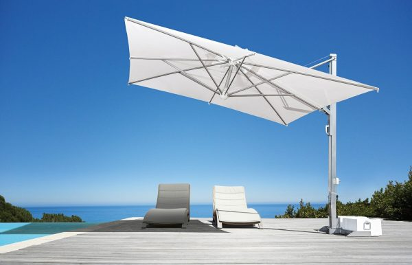 veneto umbrella with aluminum shading chairs on an infinity pool deck