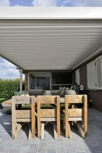 1500 Series Outdoor Shelter above a patio behind a home