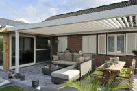 1500 Series Outdoor Shelter above a patio area behind a home
