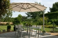 P6 Round Uno Umbrella shading an outdoor dining area