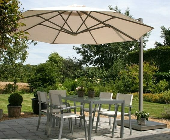 p6 round uno umbrella over an outdoor seating area on a small patio
