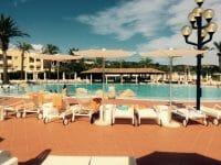 Réve Umbrella next to the pool at a resort