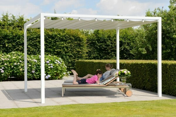 Retractable Roof Poolside Cabana with the roof closed and children sitting on lounge chairs and reading underneath