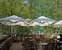 P6 Square Quattro Umbrellas at an outdoor dining area in Bryant Park