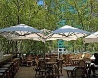 P6 Square Quattro Umbrellas at an outdoor dining area in Bryant Park