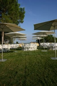 outdoor wedding setup with tables, and p50 umbrellas