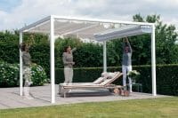 a woman opening her Retractable Roof Poolside Cabana