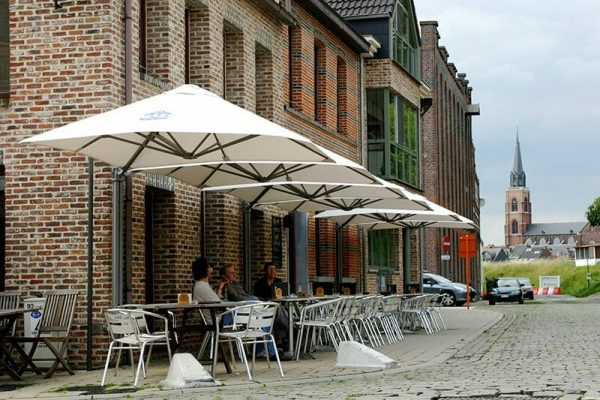 p6 square duo umbrellas covering outdoor dining areas next to a building