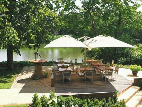 P6 Square Quattro Umbrellas at an outdoor dining area by the water