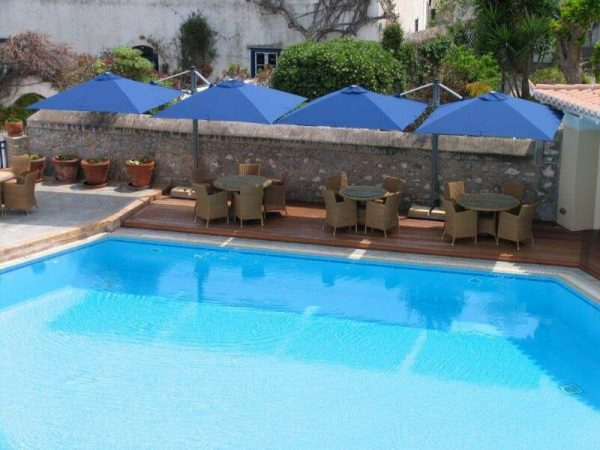 Blue P6 Square Duo Umbrellas covering poolside outdoor seating