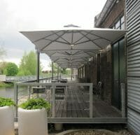 p6 square duo umbrellas on an outdoor restaurant deck