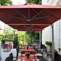 p6 square duo umbrella covering an outdoor dining area