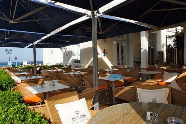 P6 Square Quattro Umbrella at Zoe's Club outdoor dining area