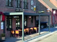 2000 Series Outdoor Shelter covering outdoor seating at De Dreef