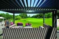 2000 Series Outdoor Shelter over an outdoor seating area looking out at a golf course