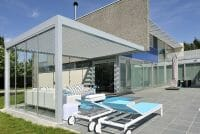 2000 Series Outdoor Shelter covering a seating area next to a pool