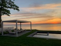 2000 series outdoor shelter covering four pool lounge chairs at dawn