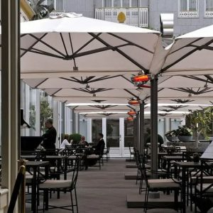 cantilevered commercial umbrellas over outdoor restaurant seating
