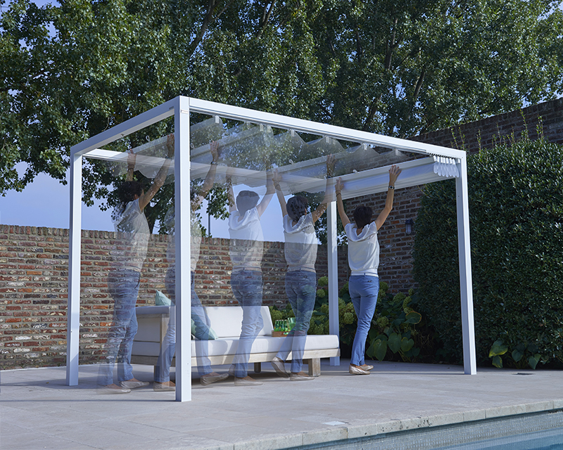 Retractable Roof Poolside Cabana showcasing a lady opening the roof