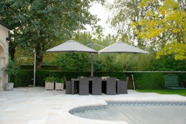p6 square duo umbrellas covering a large outdoor dining table next to a pool